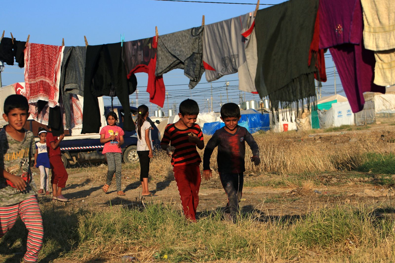 Displaced Iraqi children from the minority Yazidi sect, who fled the Iraqi town of Sinjar, play at the Khanki camp on the outskirts of Dohuk province