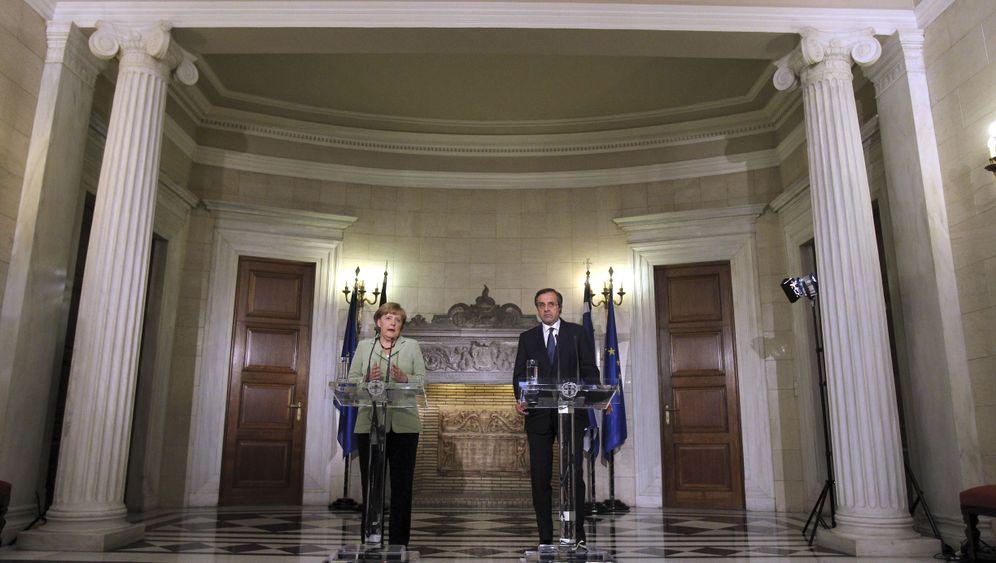 Photo Gallery: Protesters Greet Merkel in Athens
