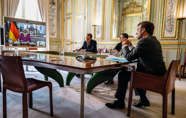 """French President Emmanuel Macron speaking with German Chancellor Angela Merkel: """"Sometimes you need to break some dishes and dispense with formalities so that new things can emerge."""""""