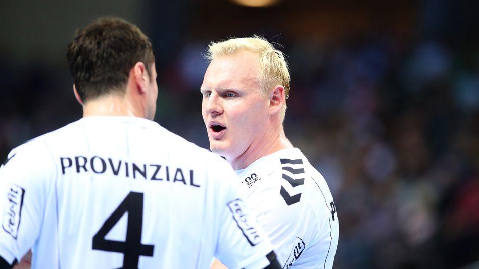 Kiels Patrick Wiencek und Teamkollege Domagoj Duvnjak gehen als neue Meister hervor