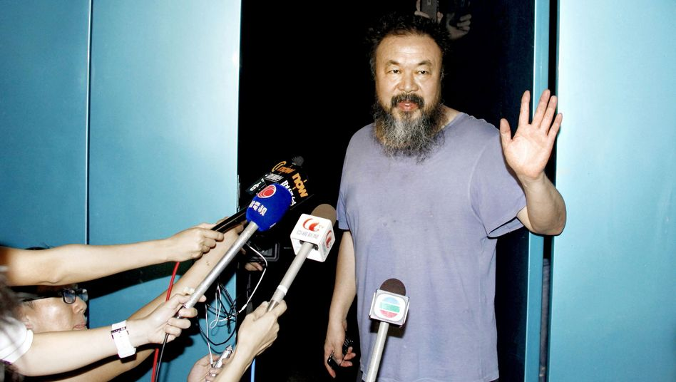 Ai Weiwei spoke to reporters outside his studio on Thursday morning.