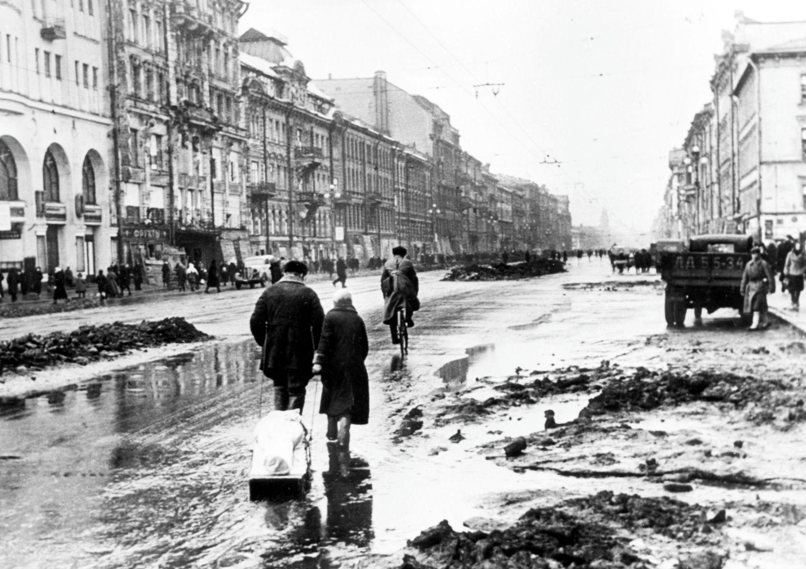 world war ll: taking a dead family member to the cemetery along nevsky prospect in leningrad during the blockade, 1942.