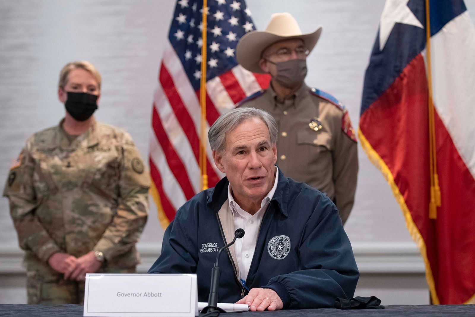 February 17, 2021, Austin, Texas, USA: Texas Gov. GREG ABBOTT and emergency officials talk with the press in the State