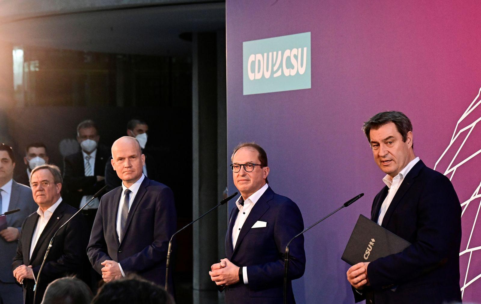 Armin Laschet, Ralph Brinkhaus, Alexander Dobrindt and Markus Soeder attend a news conference in Berlin
