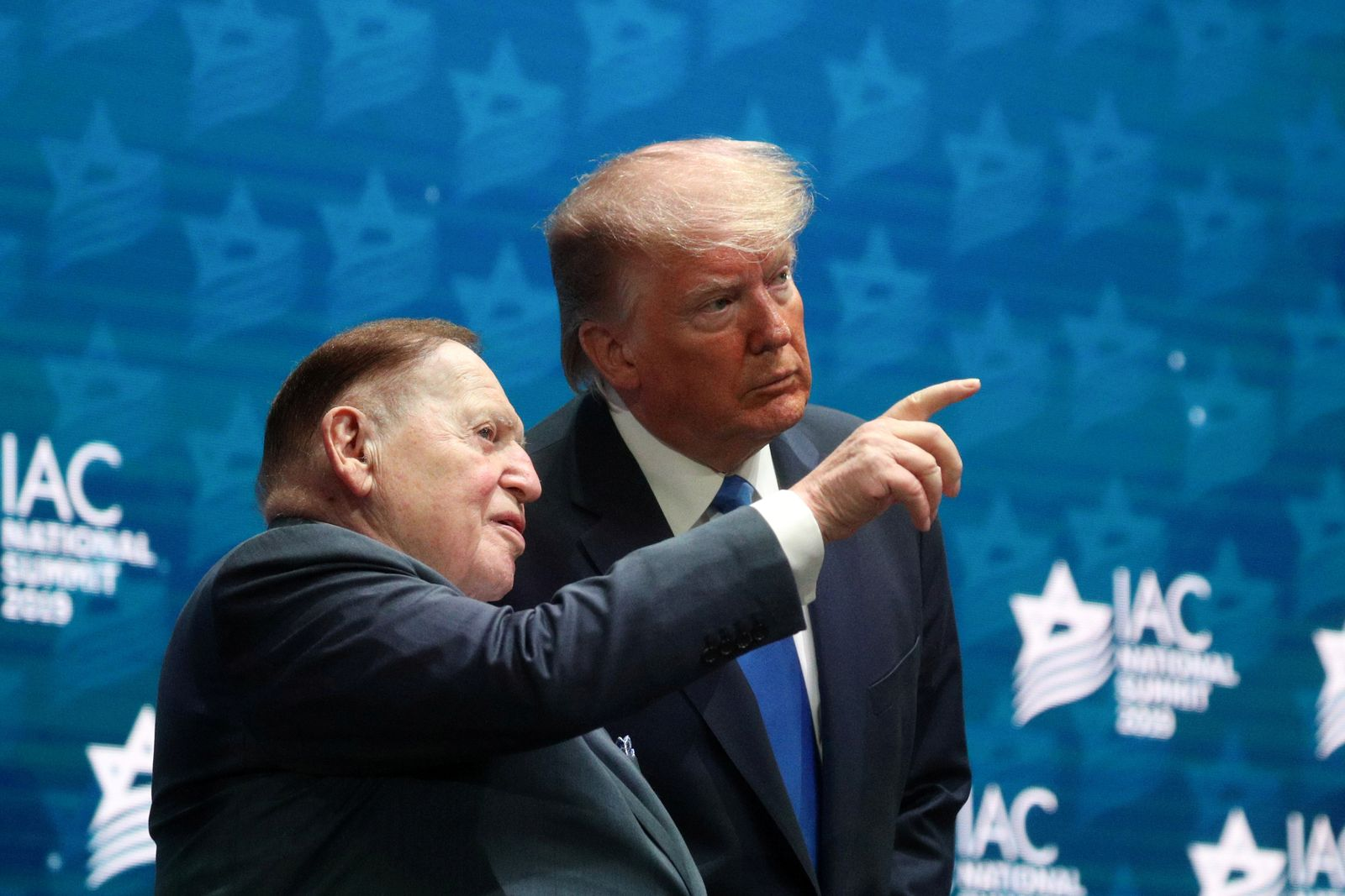 FILE PHOTO: U.S. President Trump stands on stage alongside Sheldon Adelson before delivering remarks in Hollywood, Florida