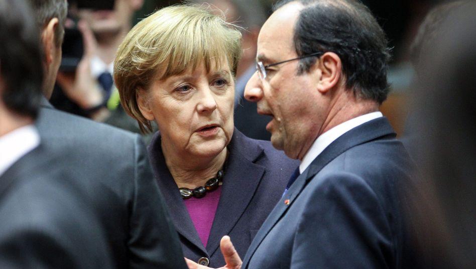 Kanzlerin Merkel und Präsident Hollande: Neue Vorschläge im Gepäck