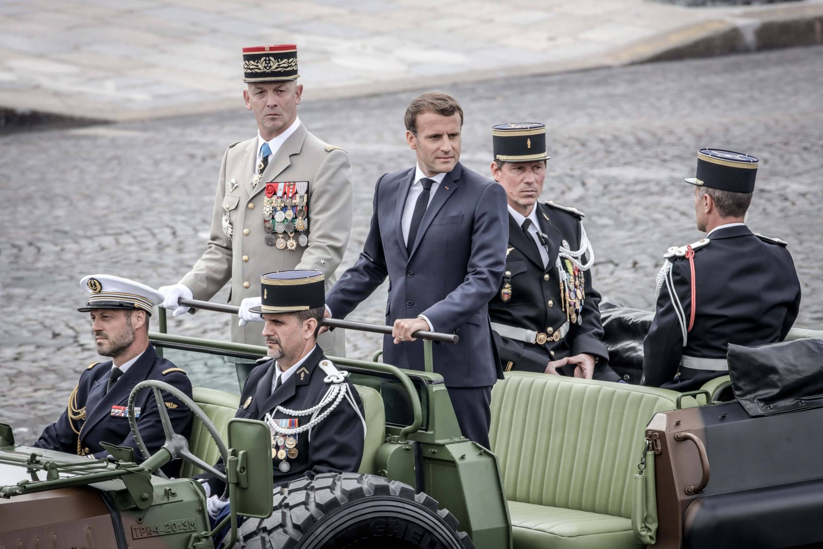 France s President Emmanuel Macron and French Armies Chief Staff General Francois Lecointre stand in the command car as