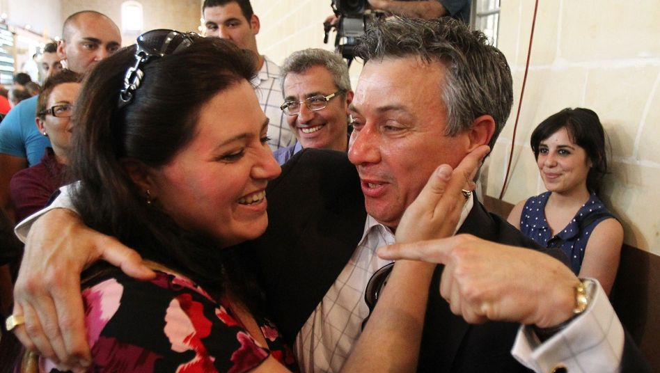 Schembri celebrates the results of Malta's referendum to legalize divorce on May 29.