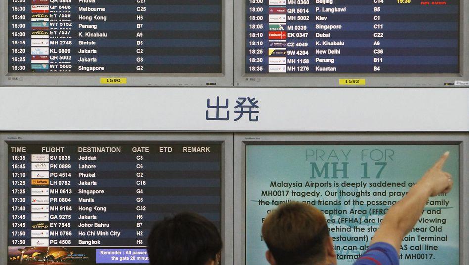 Am Flughafen Kuala Lumpur: Reisende nach dem Absturz über der Ukraine