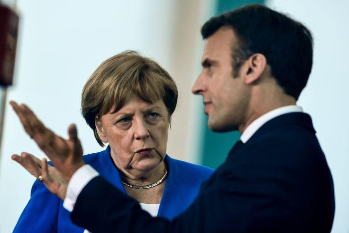 Angela Merkel, Emmanuel Macron: Paritätische Verteilung auf EU-Ebene?