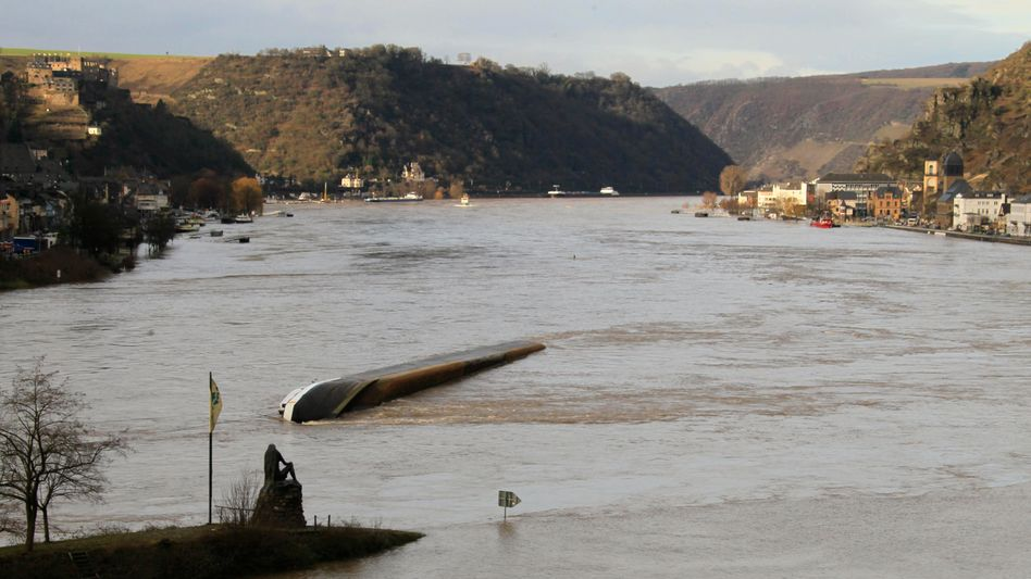 The Lorelei statue and the capsized tanker near a narrow bend in the Middle Rhine.