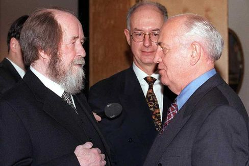 Alexander Solzhenitsyn chats with Mikhail Gorbachev during a reception in honour of Solzhenitsyn at the Swedish embassy in Moscow.