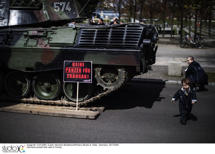 "Activists in Berlin protest a possible weapons deal for Turkey. The sign reads: ""No tanks for Erdogan."""