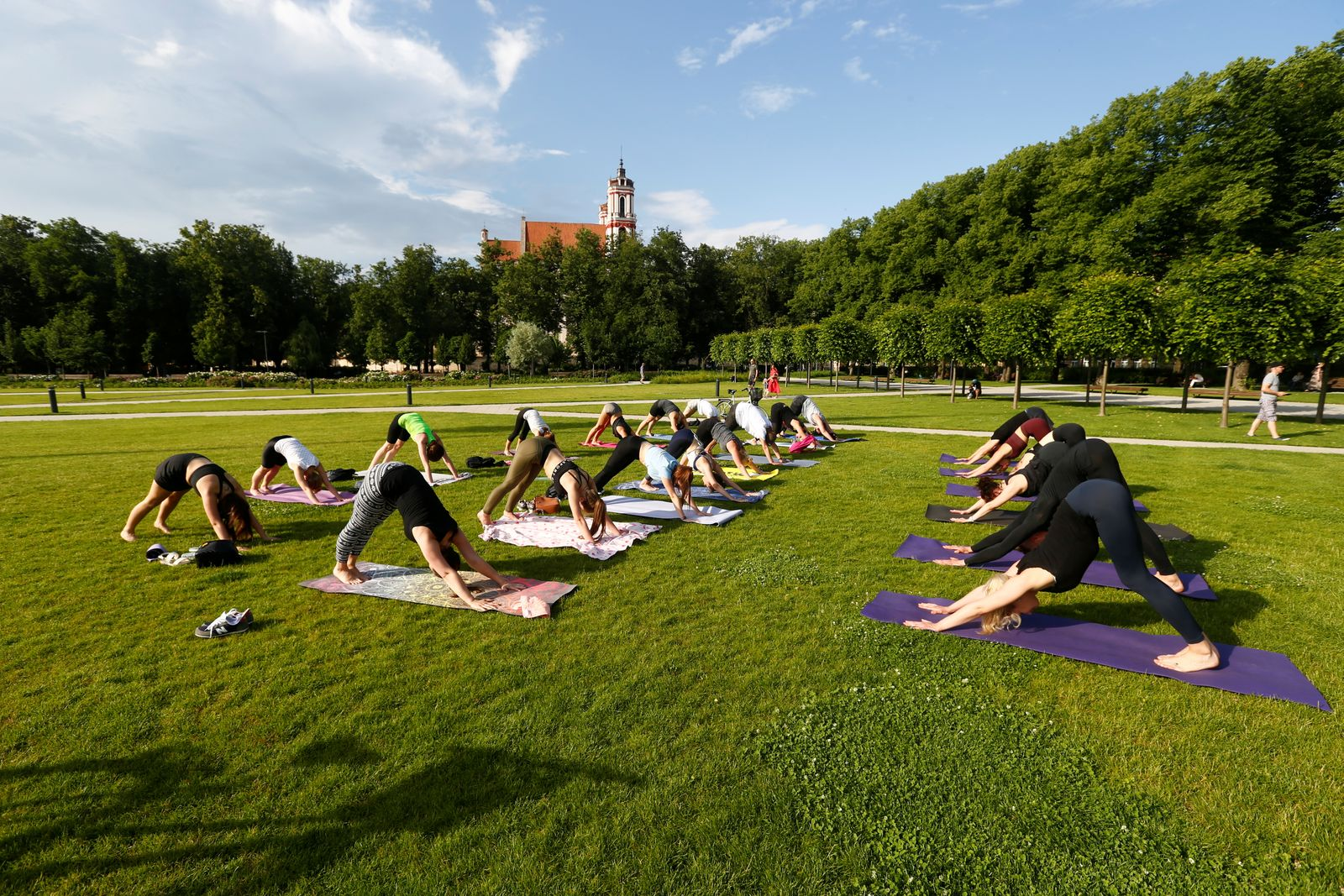 People perform yoga in the Lukiskes square during the India-themed weekend in Vilnius