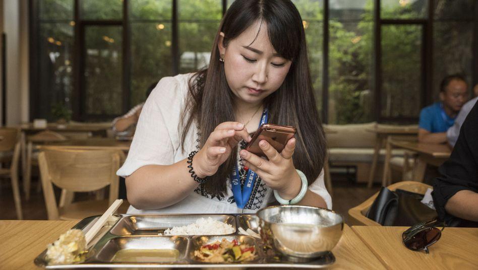 WeChat-Nutzerin Su beim Frühstück