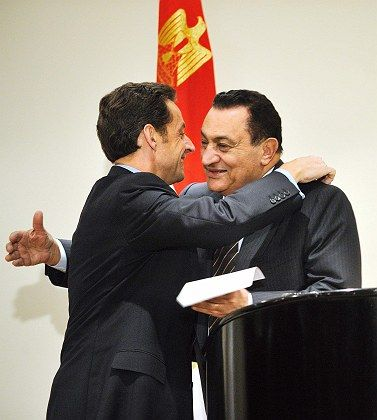 "Egypt's President Hosni Mubarak (R) and France""s President Nicolas Sarkozy embrace after a joint news conference on Tuesday."