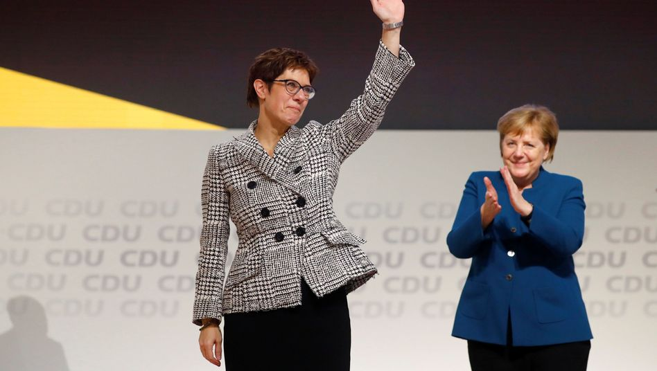 Annegret Kramp-Karrenbauer and Chancellor Angela Merkel on Friday