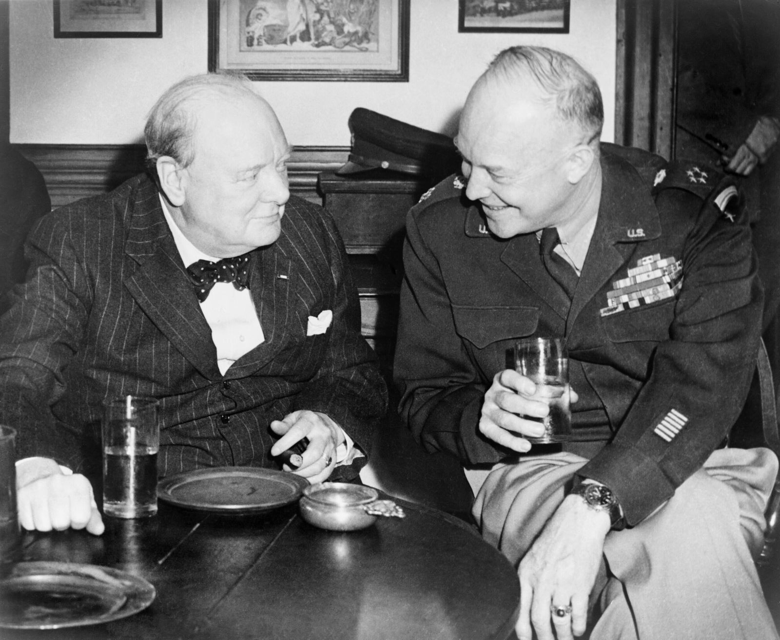 Winston Churchill (1874-1965), and General Eisenhower, enjoy a drink at the Raleigh Tavern in Colonial Williamsburg, dur