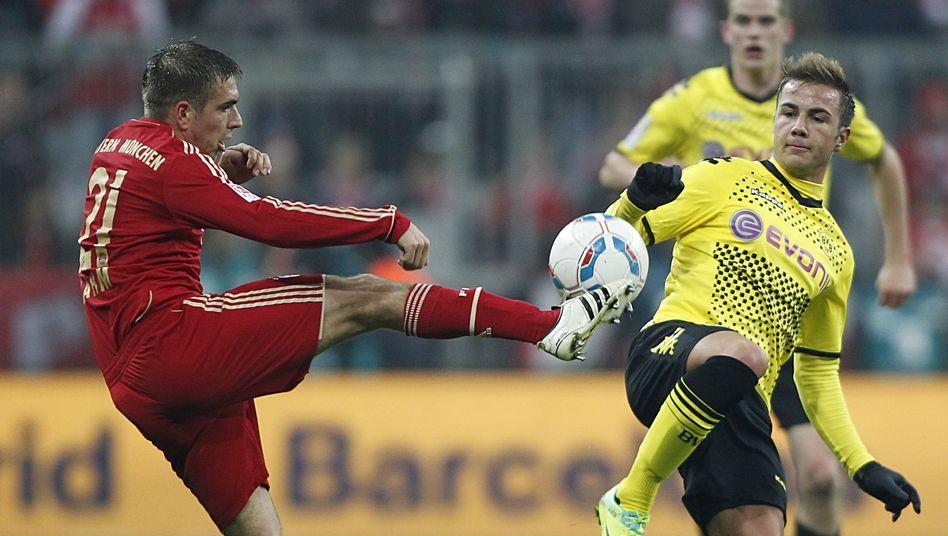 Bayerns Lahm (l.), Dortmunds Götze: Entscheidendes Duell im April