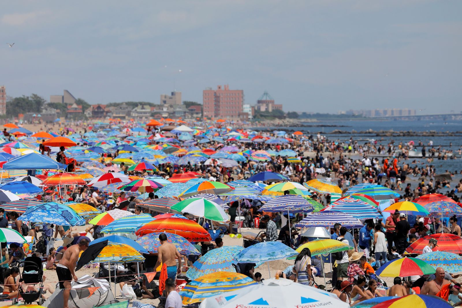 People gather on Coney Island beach on the Independence Day holiday in Brooklyn, New York City