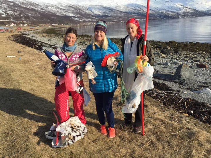Crown Princess Mette Marit of Norway (center) collecting trash on the beaches of Norway in 2015.