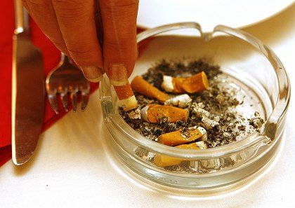 Just too tempting? Portugal's anti-smoking chief couldn't even last a day after a smoking ban was introduced.