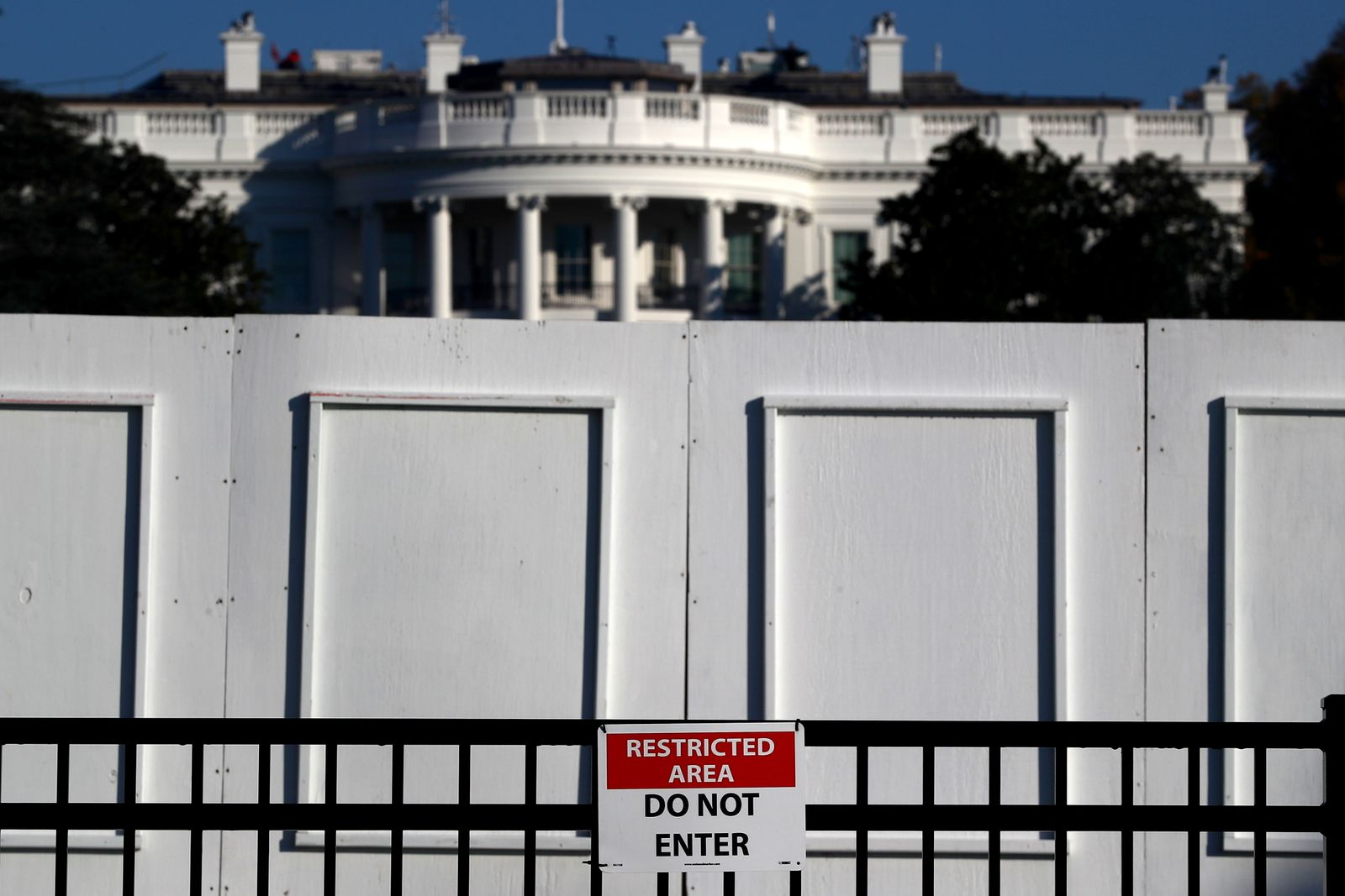 """A """"Do Not Enter"""" sign hangs on a fence in front of the White House, days after former Vice President Joe Biden was declared the winner of the 2020 U.S. presidential election, in Washington, DC"""