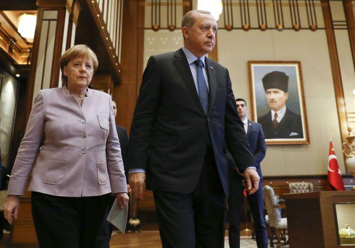 German Chancellor Angela Merkel and Turkish President Recep Tayyip Erdogan during their meeting inside the presidential palace in Ankara on Feb. 2.