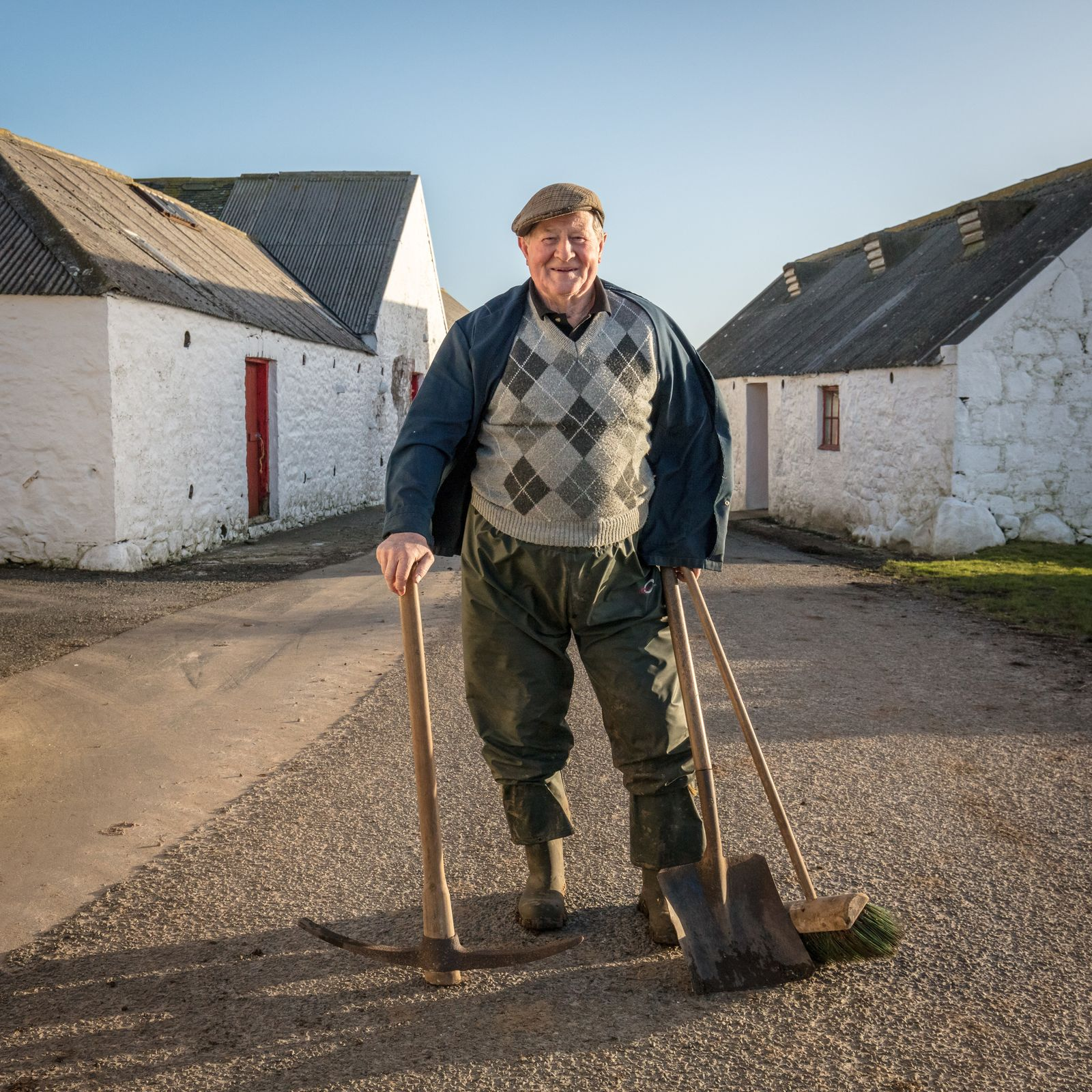 Hughes of Knockencule Farm on the way to feed his cows. There are a handful of derelict crofts on his land that once housed seven people that used to work with him. Today he manages the farm mostly a