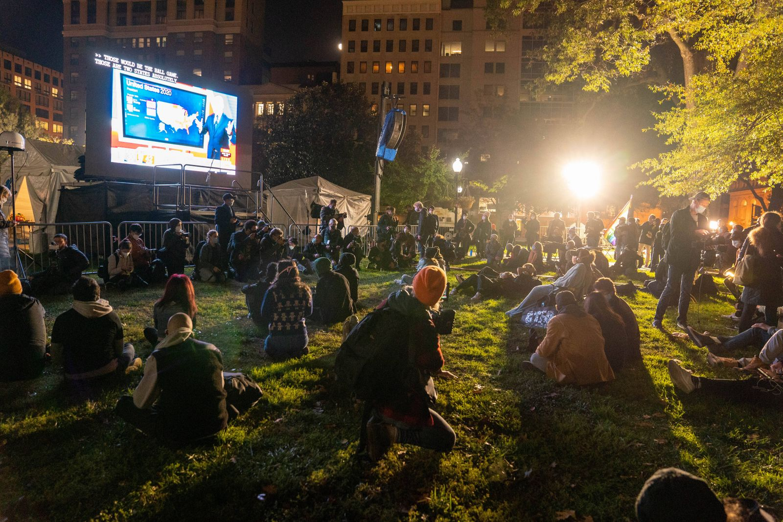 Watch party goers gather at McPherson Square near the White House on election night in Washington, DC on Tuesday, Novem