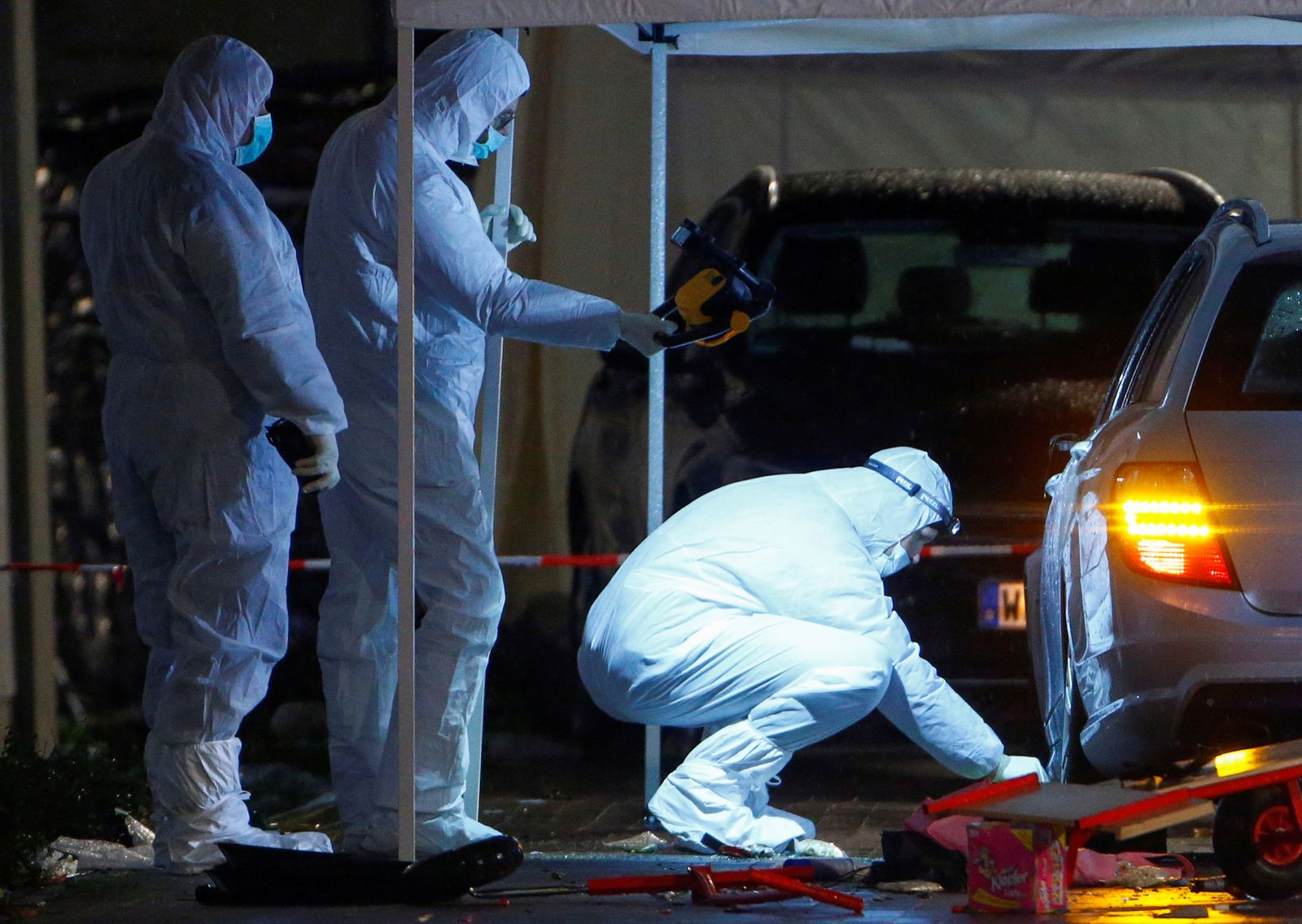 Police forensic officers work at the scene after a car ploughed into a carnival parade injuring several people in Volkmarsen