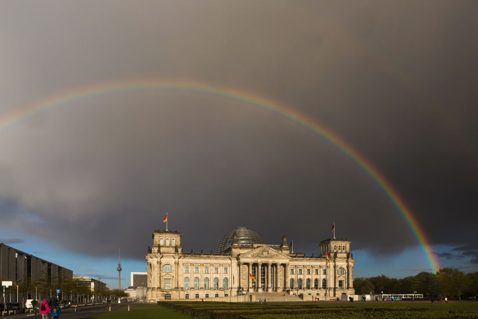 Full rainbow over the Reichstag (parliament building) in the german capital Berlin - very rare scene