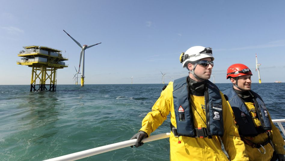 Technicians inspect the Alpha Ventus wind farm near the German North Sea island of Borkum. The 12 wind turbines are intended to provide electricity for 50,000 households.