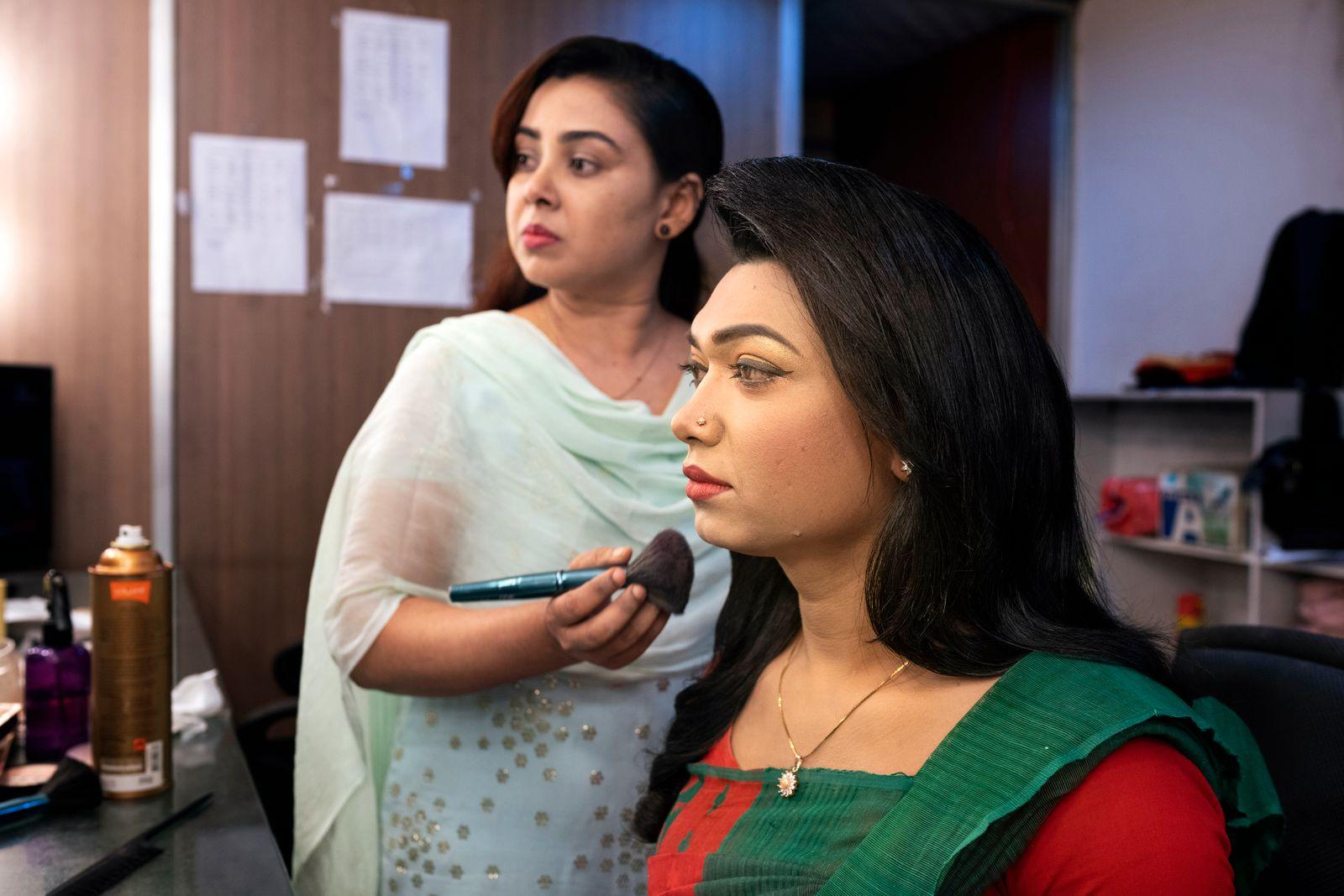 Tashnuva Anan Shishir, seated, prepares to present the news at the Boishakhi TV studio in Dhaka, Bangladesh, on Saturday, March 13, 2021. (Fabeha Monir/The New York Times)