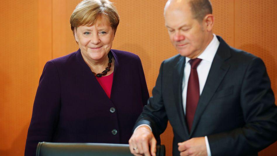 Kanzlerin Angela Merkel begrüßt eine Finanztransaktionssteuer