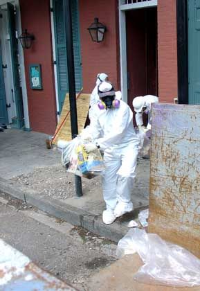 Clean-up work takes place at a French Quarter bar.