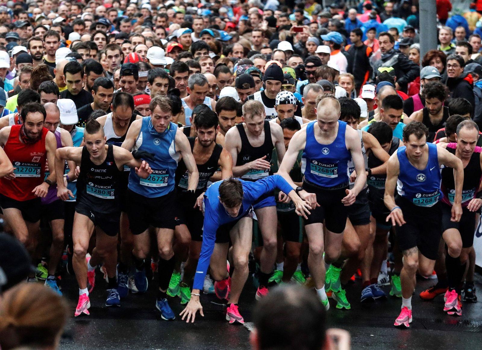 People take part in the Zurich Marathon of San Sebastian, Basque Country northern of Spain on 24 November 2019. Zurich