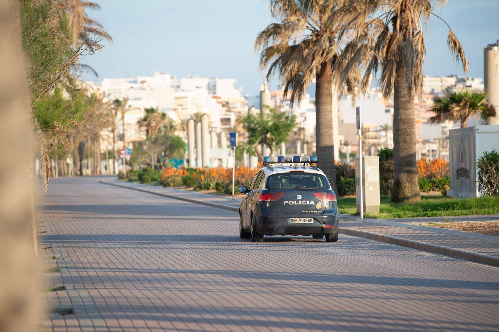 20200423 Corona Lock down in Mallorca PALMA DE MALLORCA, SPAIN - APRIL 23 2020 : Car of the Policia National ant the Pl