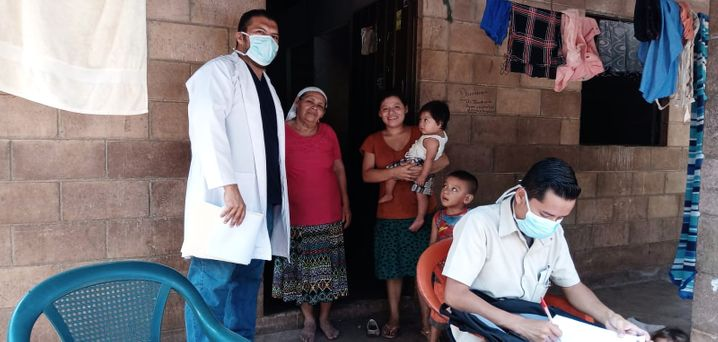 Members of a health team from Glasswing International educate people about the coronavirus and protective measures -- and try to identify COVID-19 symptoms as early as possible.