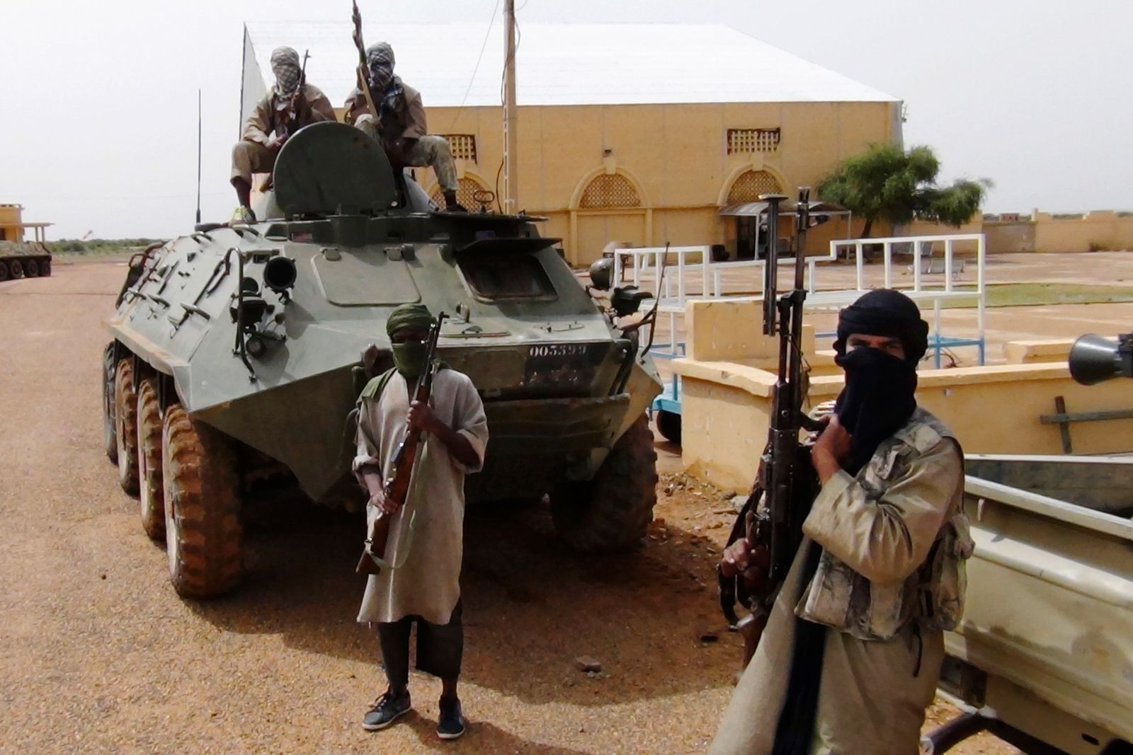 Fighters from the Al Qaeda-linked Islamist group MUJWA stand guard in Gao