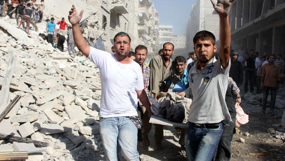 Syrier bringen in Aleppo einen Verletzten weg: Gespräche für Friedenskonferenz verschoben