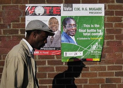 Campaign posters for President Robert Mugabe (R), and opposition leader Morgan Tsvangirai (L), who has now pulled out of the race due to the violence and intimidation.