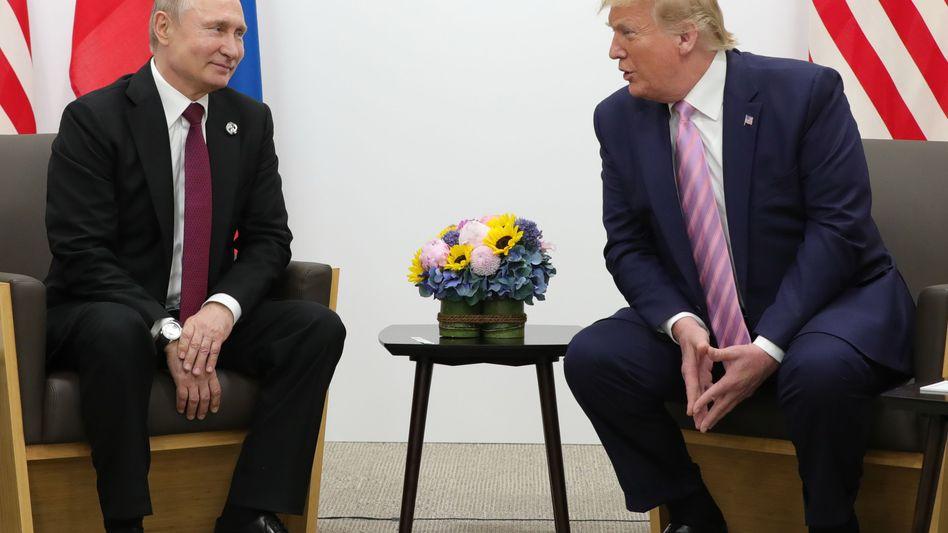 Bitte lächeln: Russlands Präsident Wladimir Putin und US-Präsident Donald Trump in Osaka beim G20-Gipfel