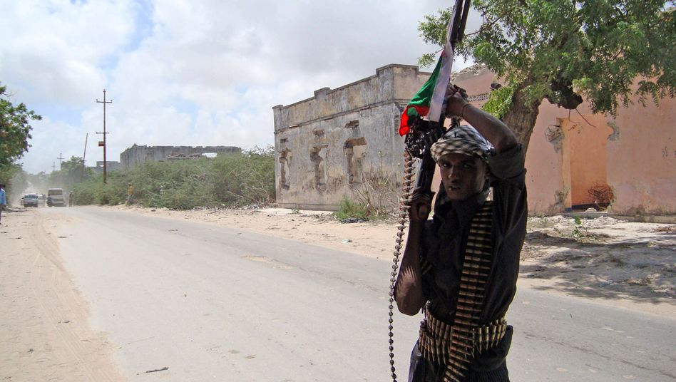A member of a pro-government militia in Mogadishu: A German security firm has signed a deal to provide security for a Somali warlord.