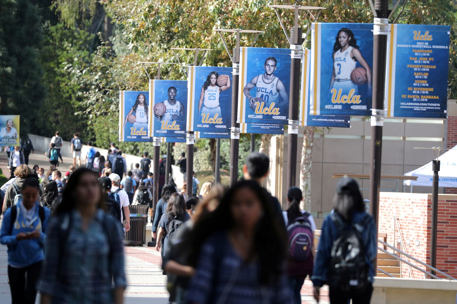 FILE PHOTO: University of California Los Angeles (UCLA) students walk on the UCLA campus in Los Angeles