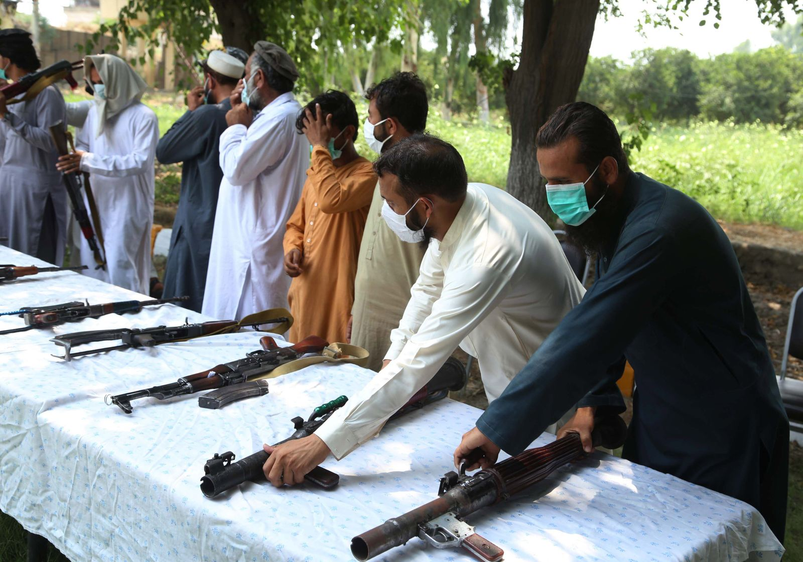 Militants surrender their weapons during a reconciliation ceremony in Jalalabad, Afghanistan - 27 Jul 2020