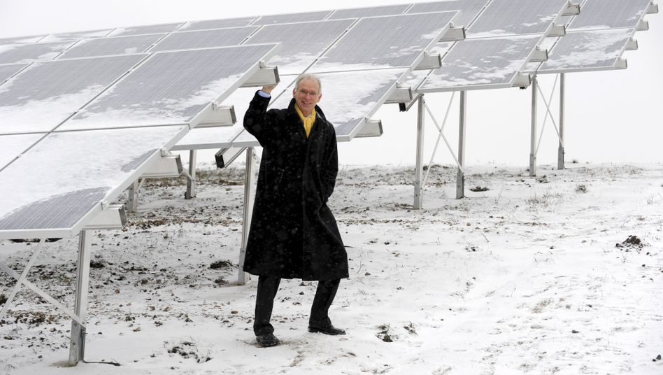 Hamburg Energie CEO Michael Beckereit poses by solar panels: The new public utility is currently winning between 50 and 100 new customers each day.