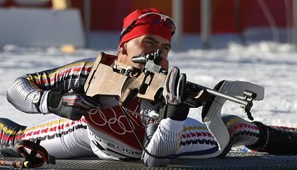 Germany's Michael Greis lies at the shooting range while training for the 10km men's sprint at the Biathlon field during the Turin 2006 Winter Olympic Games onFebruary 13 in Cesana San Sicario.