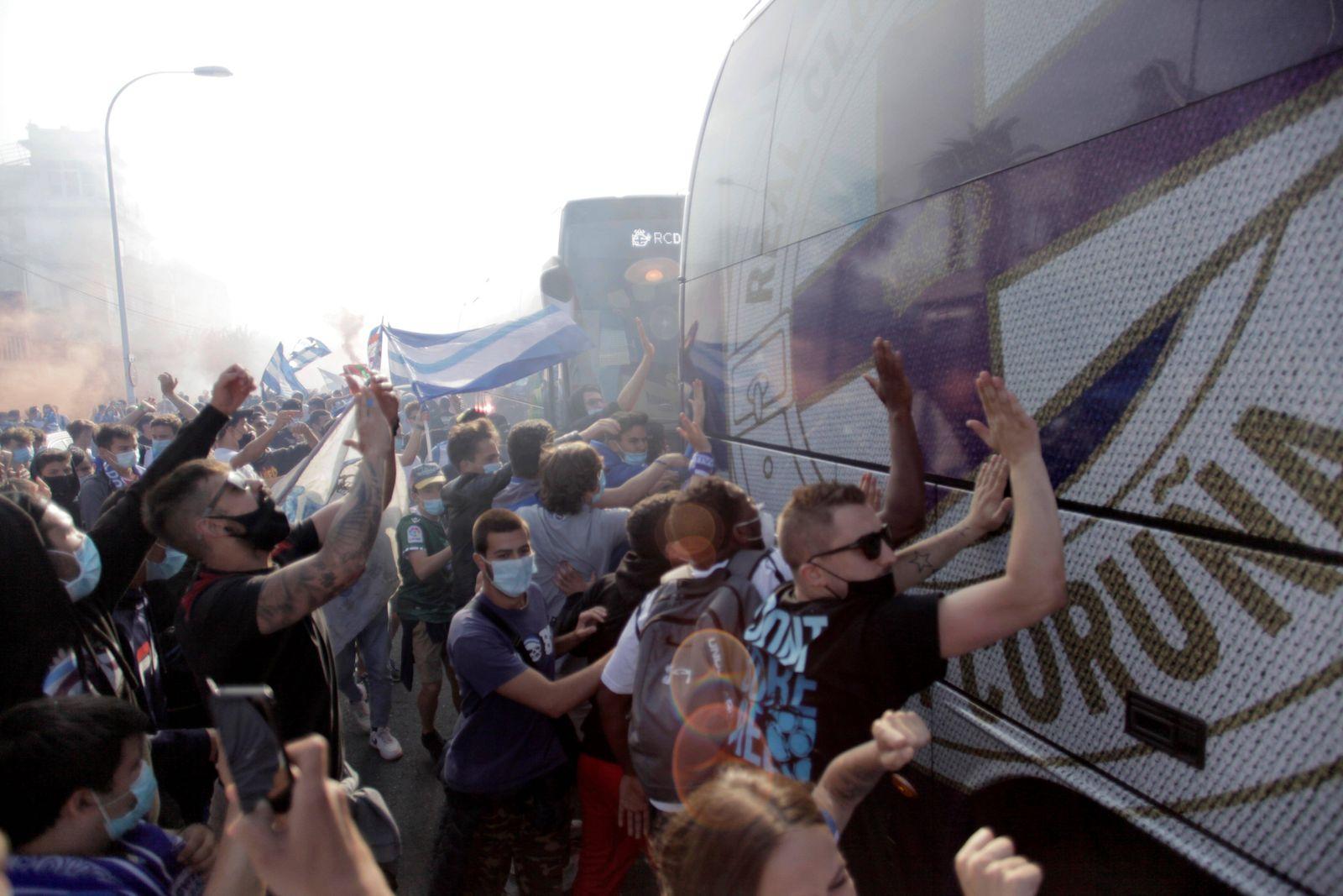 Supporters of Deportivo La Coruna spanish soccer team wave flags as they gather at Riazor Stadium, in La Coruna, northe