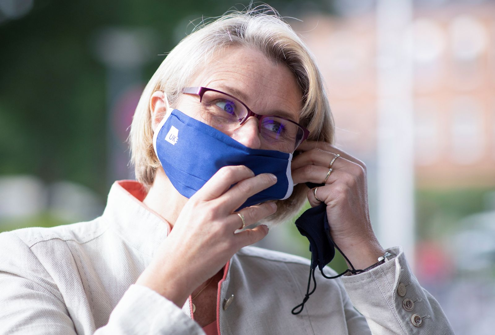 German minister for Education and Research Karliczek puts on a face mask during her visit to the Hamburg-Eppendorf university clinic in Hamburg